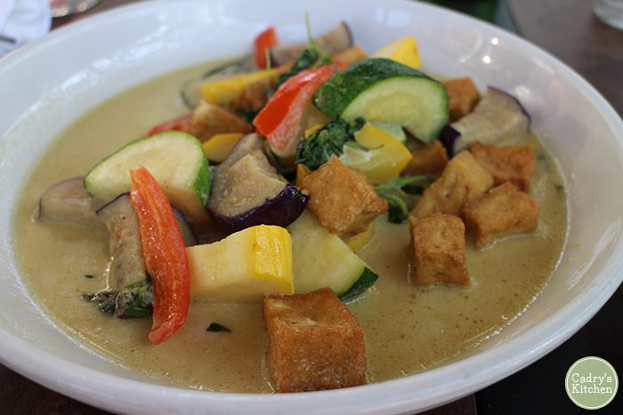Coconut milk curry with tofu in bowl.