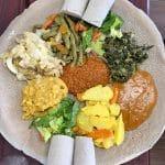 Overhead Ethiopian wots on injera.