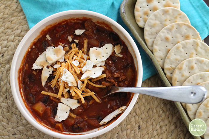 This vegan 2 bean & Soy Curl chili will satisfy the hungriest of appetites | cadryskitchen.com