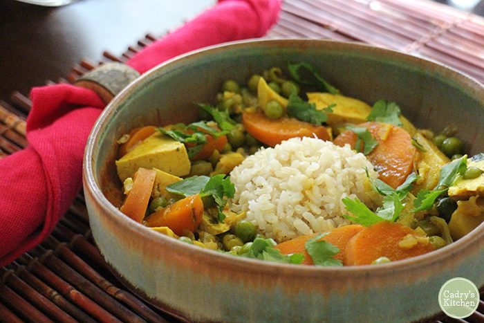Down home curry in bowl with tofu and carrots.
