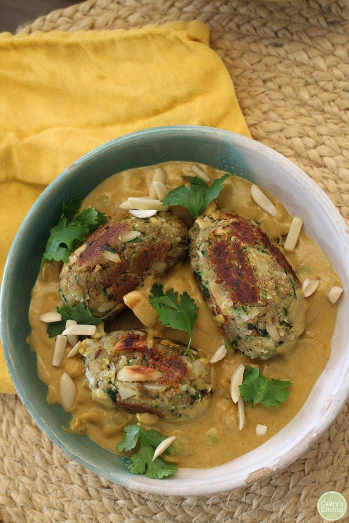 Overhead malai kofta in bowl with sauce.