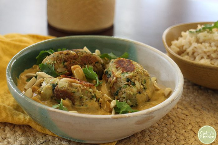 Malai kofta in bowl with creamy sauce.