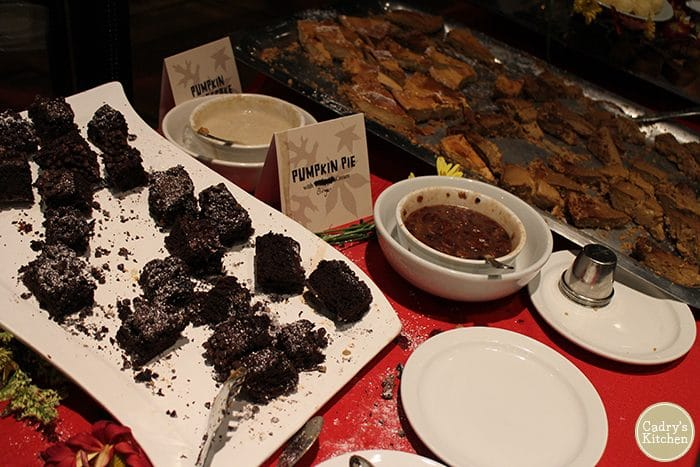 Dessert buffet area with pumpkin pie and chocolate brownies.