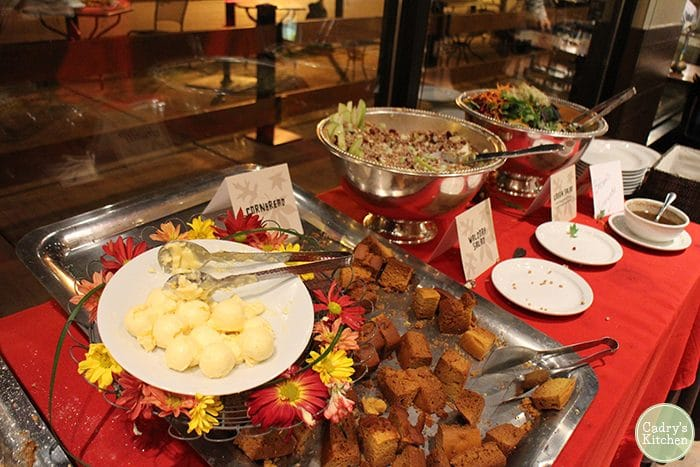 Buffet area with non-dairy butter and cornbread.