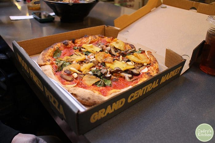 Cheeseless pizza in box at Grand Central Market in Los Angeles, California.