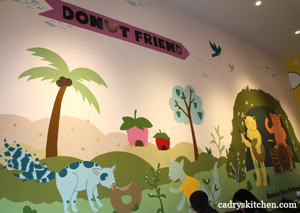 Mural of animals eating donuts and playing instruments at Donut Friend.