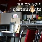 Text overlay: Vegan tips. Options at non-vegan restaurants. Table & chairs at diner.