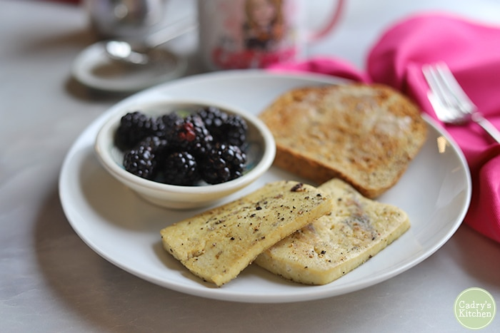 Vegan eggs on plate with berries and toast.