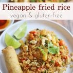 Text overlay: Pineapple fried rice. Vegan and gluten-free. Plate with rice, spring roll, and limes.