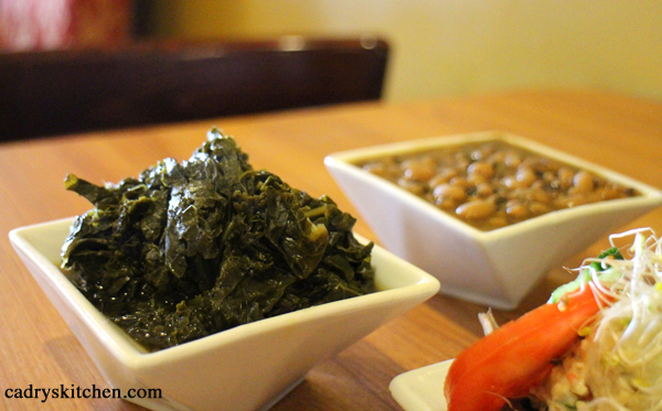Greens and black-eyed peas in bowls.