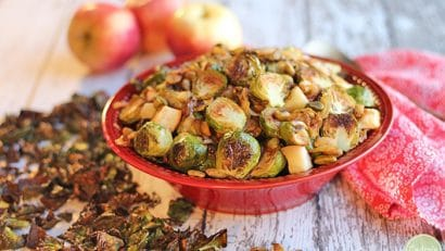 Bowl of roasted Brussels sprouts with apples and caramelized onions.