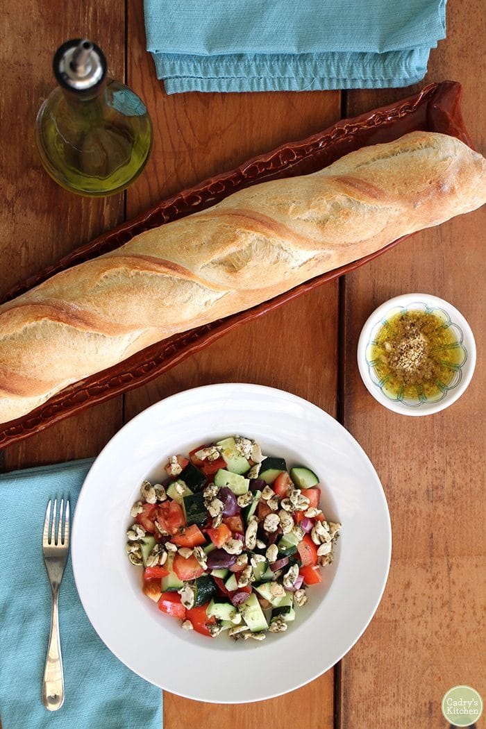 Salad with cashew feta, dukka, and baguette