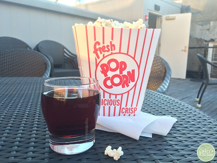 Popcorn and wine at rooftop film screening.