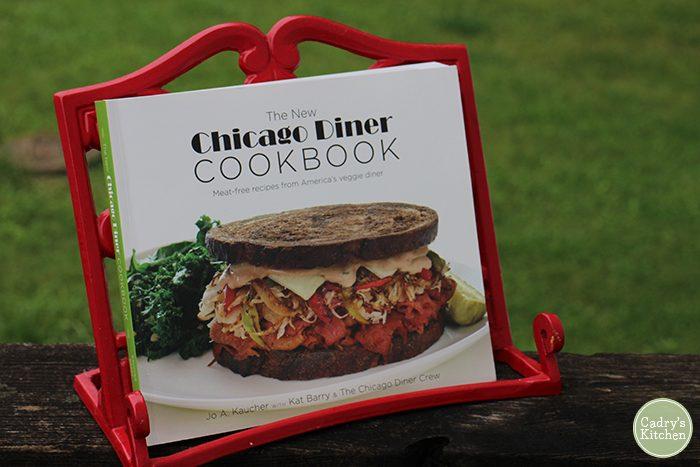 Chicago Diner cookbook in red cookbook stand.