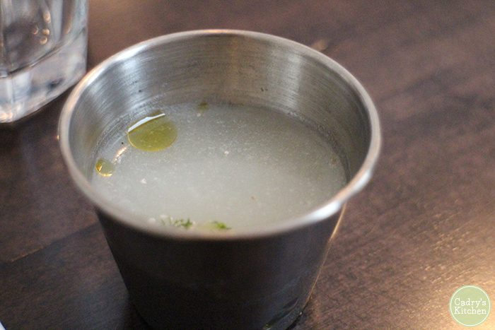 Stainless steel cup of corn milk.