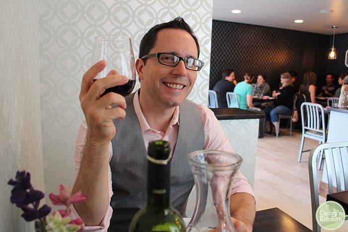 David holding wine glass in Modern Love.
