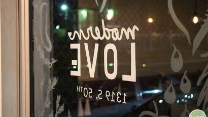 Glass window pane at Modern Love Omaha.