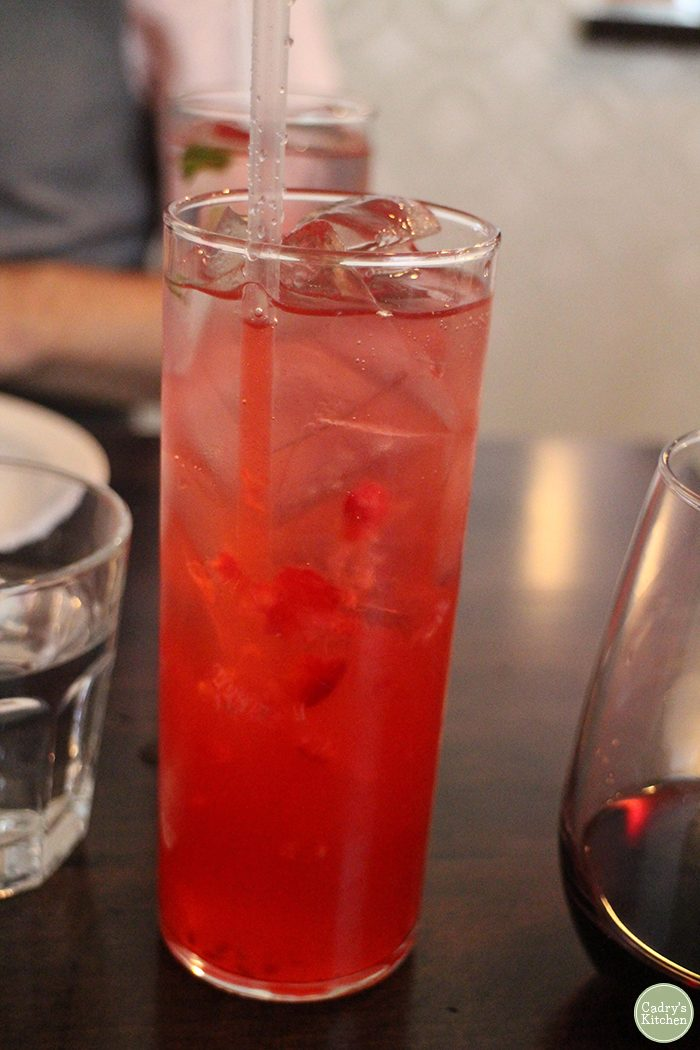 Raspberry lemonade in tall glasses.