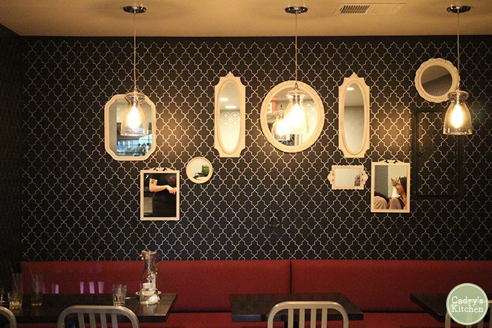Mirrors on the wall and long booths at Modern Love.