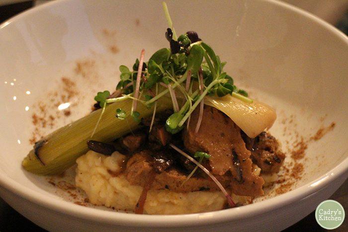 Seitan marsala in bowl with potatoes.