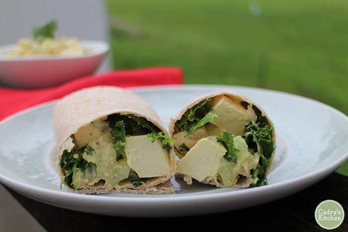 Eggless salad with kale in wrap on plate.