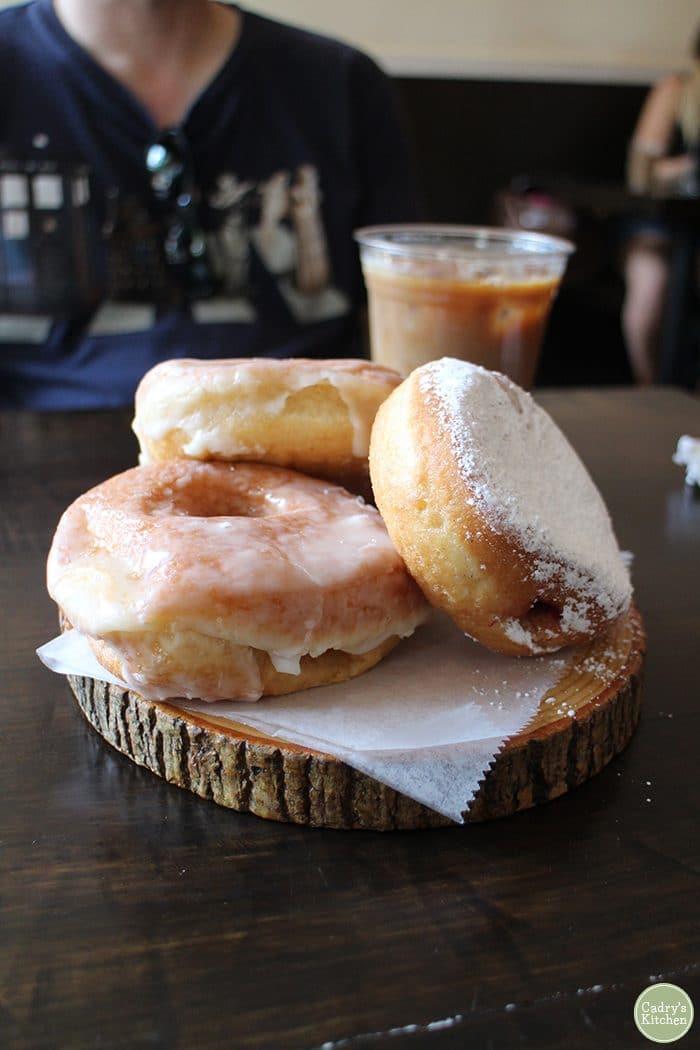 Wood platter of vegan donuts at Dun-Well.