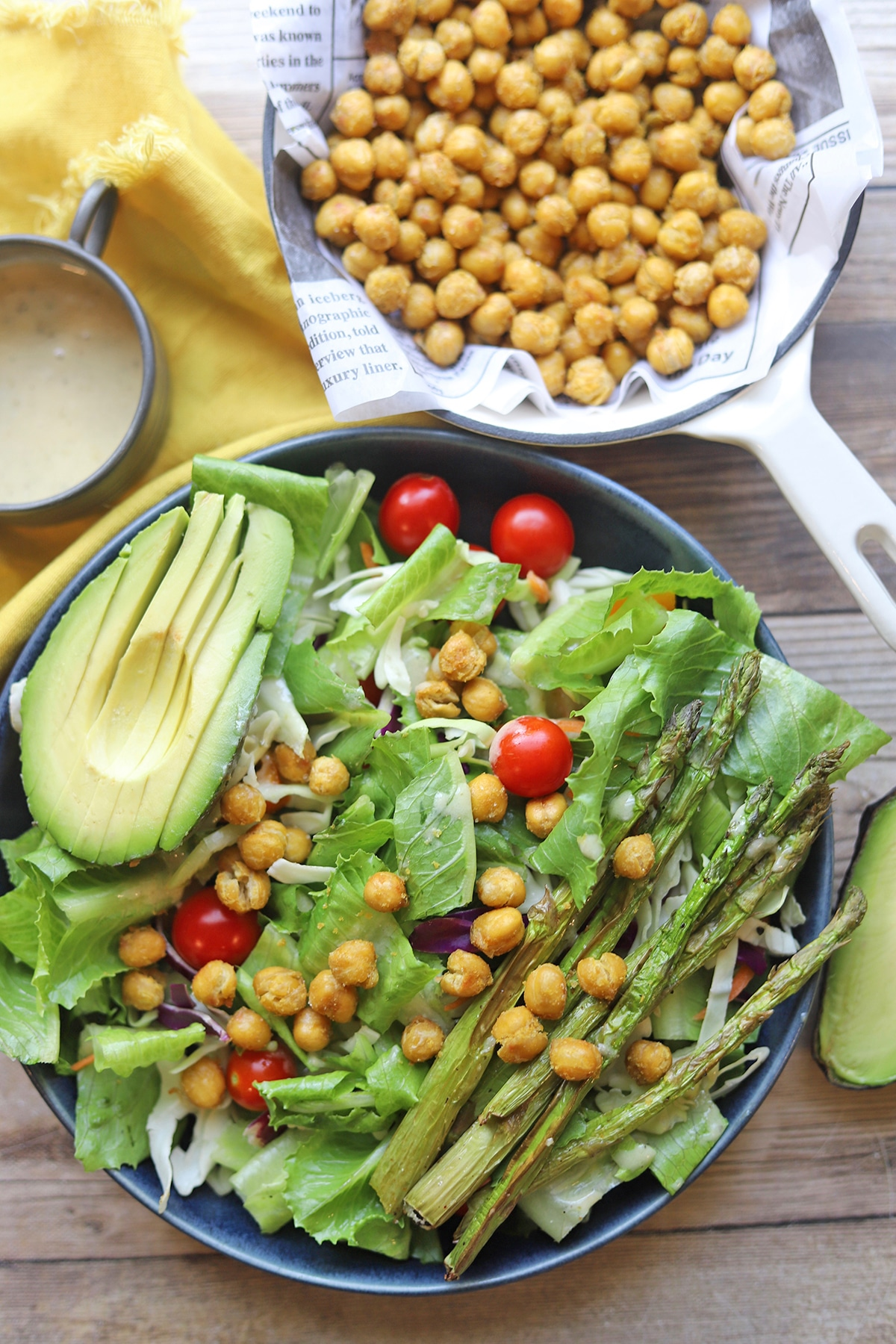 Overhead salad with avocado and roasted garbanzo beans.