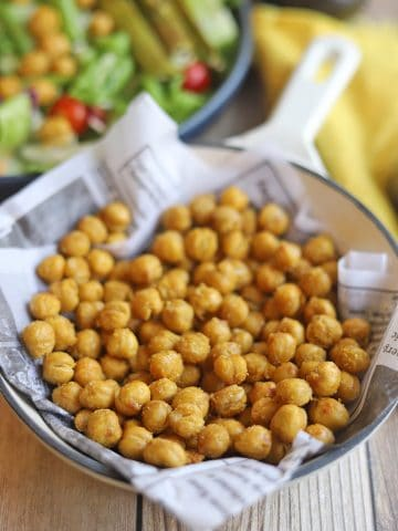 Roasted chickpeas in skillet.