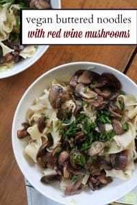 Text: Vegan buttered noodles with red wine mushrooms. Overhead bowls of noodles covered in red wine infused mushrooms.