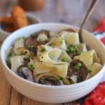 Bowl of pappardelle tossed with sauteed garlic and non-dairy butter.