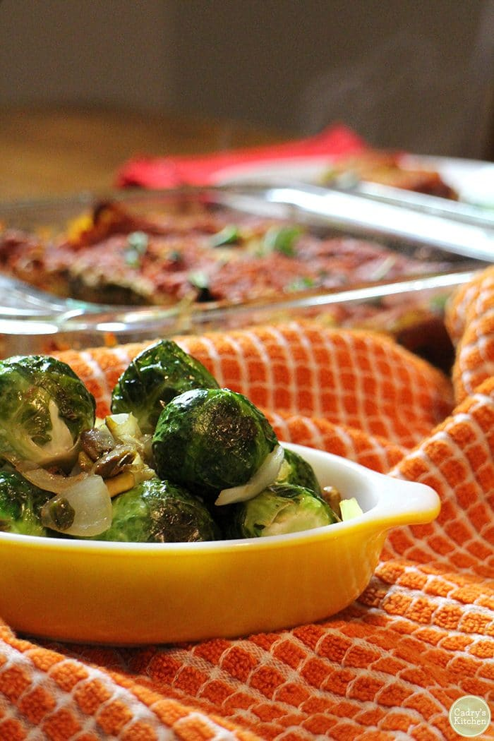 Roasted Brussels sprouts in a Pyrex dish.