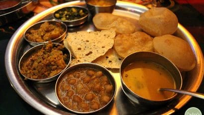 Curries and bread on tray at Vatan in New York City.