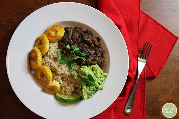 Boozy black bean and rice bowls: A vegan & gluten-free bowl with plantains, guacamole, rice & beans. | cadryskitchen.com