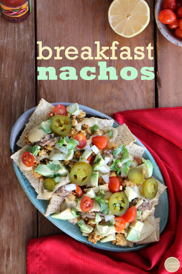 Vegan breakfast nachos with refried beans, tofu scramble, and cashew queso. This is the way to start the day! | cadryskitchen.com #vegan