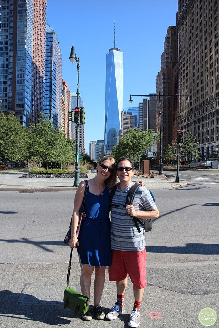 Cadry and David in front of One World Trade Center in New York City, New York.