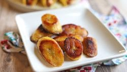 Fried plantains on plate with napkin.