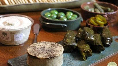 Treeline cheese with dolmas, Castelvetrano olives, pickles, and jalapeno peppers.
