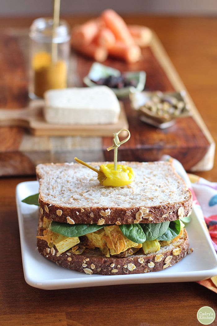 Tofu salad sandwich with spinach.