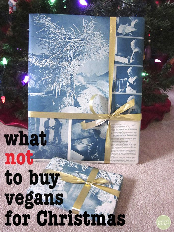 "Wrapped present under Christmas tree + text ""What not to buy vegans for Christmas"""