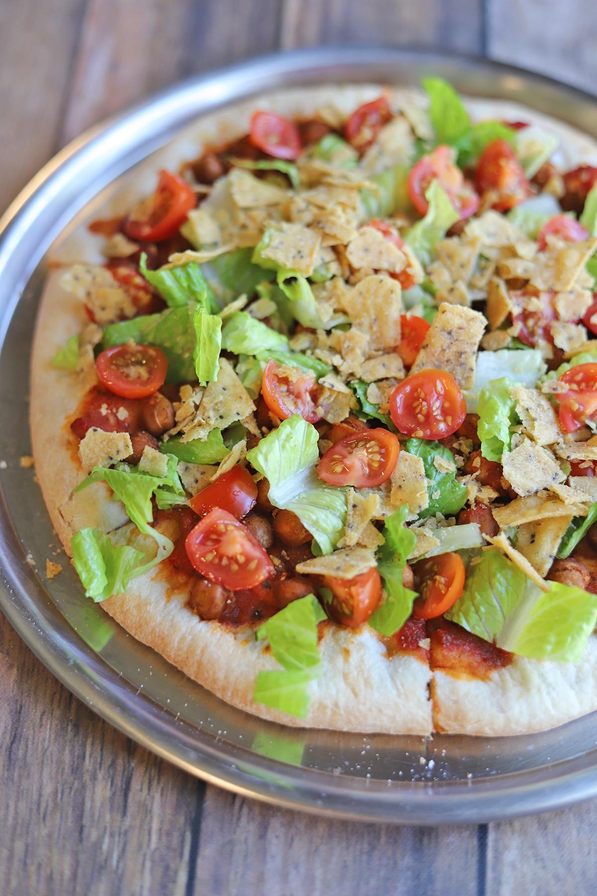 Overhead taco pizza on pan.