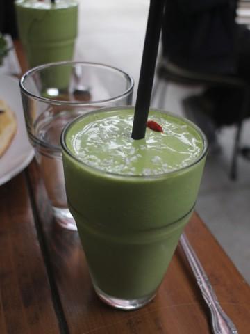 Cashew kale shake in glass at Sun Cafe.