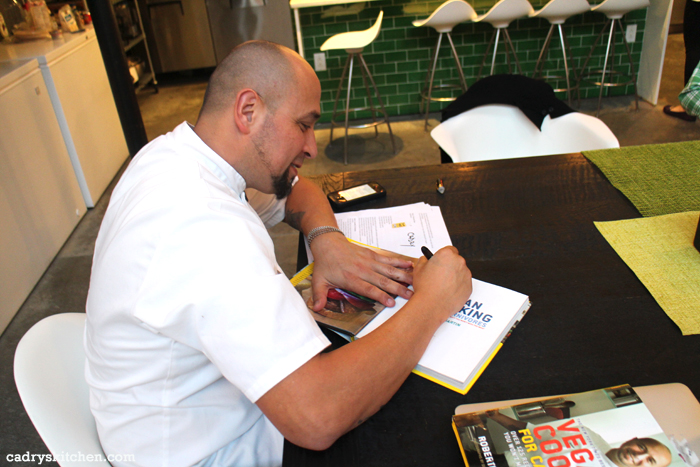 Chef Roberto Martin autographing book.