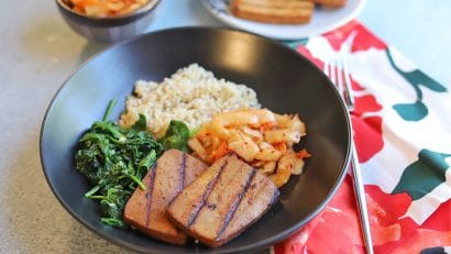 Bulgogi tofu in bowl with kimchi, spinach, and rice.