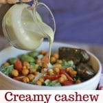 Text overlay: Creamy cashew salad dressing. Vegan & gluten-free. Dressing being poured over salad in bowl.