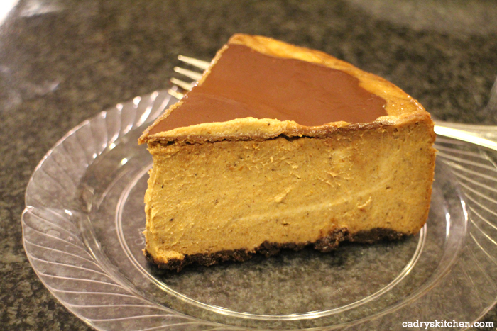 Slice of pumpkin cheesecake on plate.