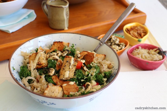 Creamy cashew salad dressing on kale salad with croutons.