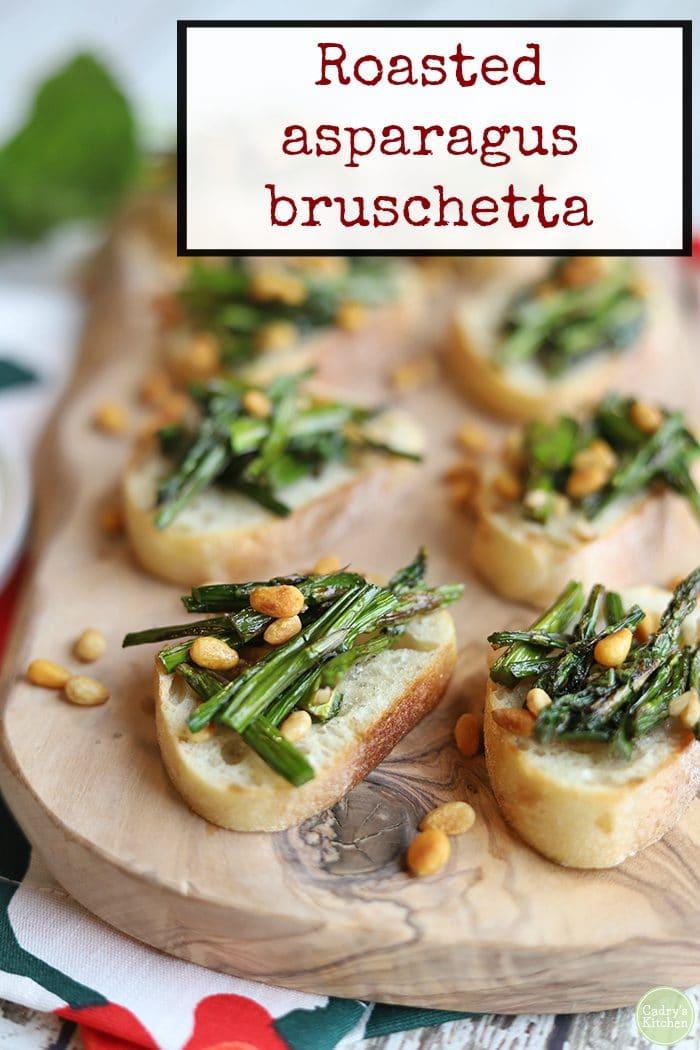 Text: Roasted asparagus bruschetta. Asparagus appetizer on board.