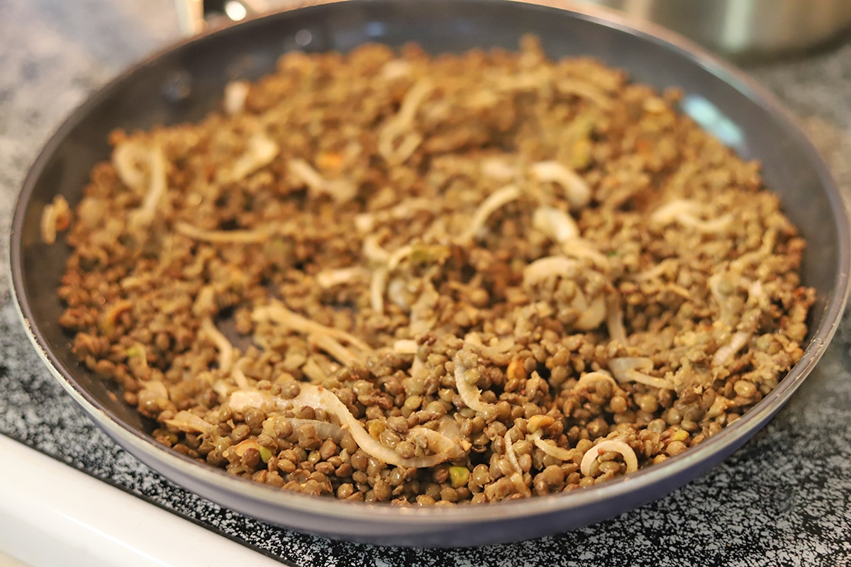 Skillet with Puy lentils, caramelized onions, and pistachios.