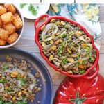 Text overlay: French lentils with caramelized onions & pistachios. Overhead table with lentils, kale, and tater tots.