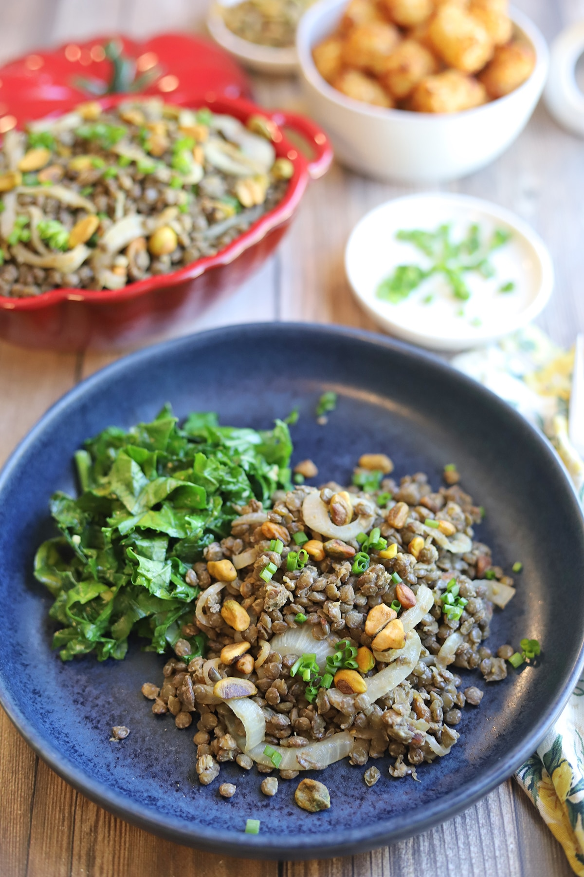 Blue plate with sauteed kale and lentils.